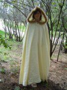 Cream Brocade Cloak with Satin Lining and a Feather Trim