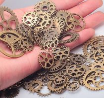 Pack of 100 Metal Gears for Steampunk Embellishment or Jewelry in Antique Brass Finish - Mixed Gear Sizes
